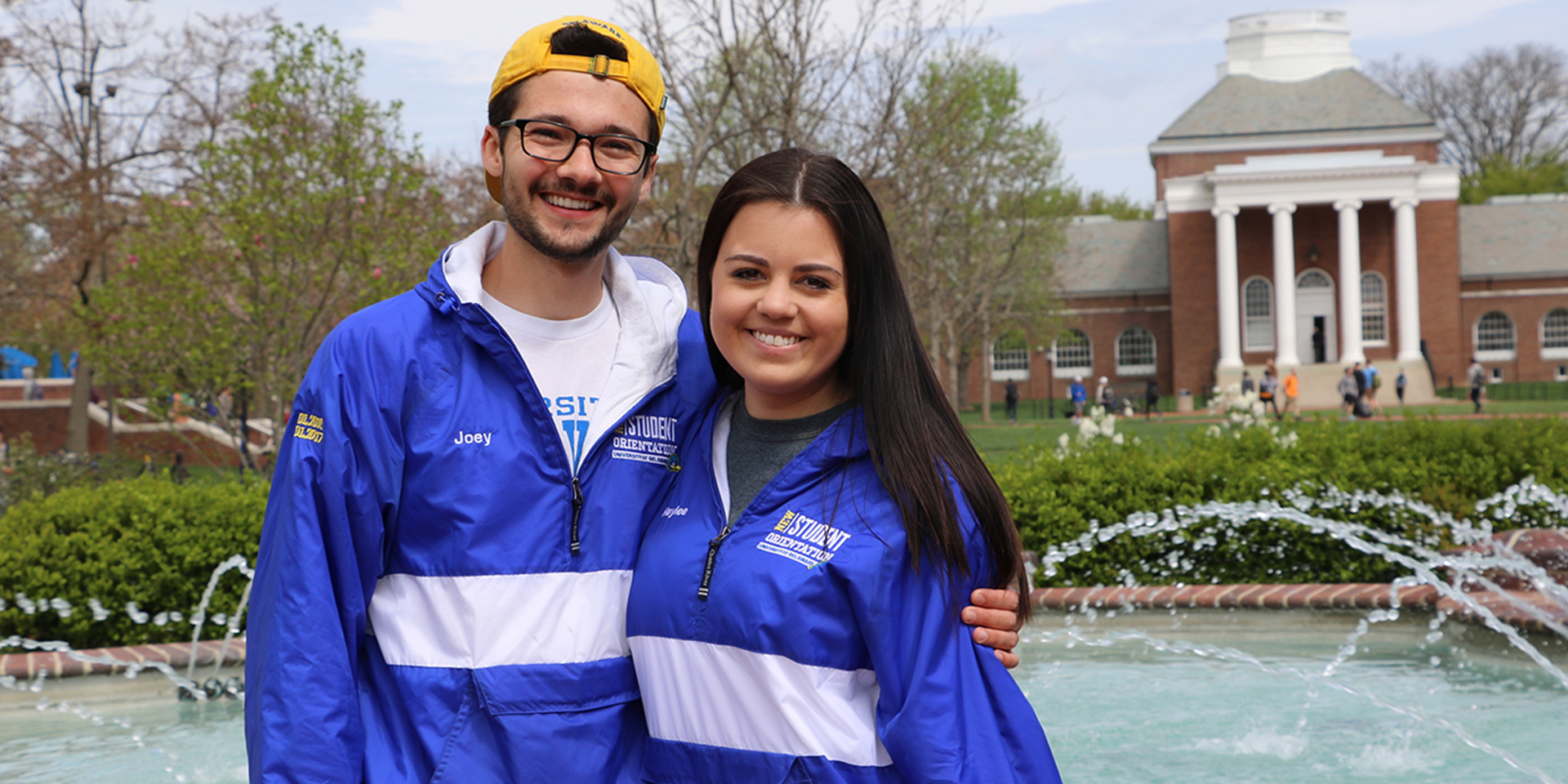 Two University of Delaware students smiling at Memorial Hall