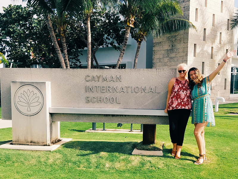 Two UD students posing outside the Cayman International School