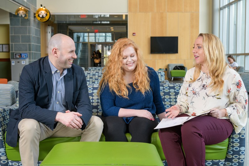 Joshua Wilson (left), assistant professor in the University of Delaware's School of Education, with undergraduate research assistants Mckenna Winnie (center) and Ally Raiche