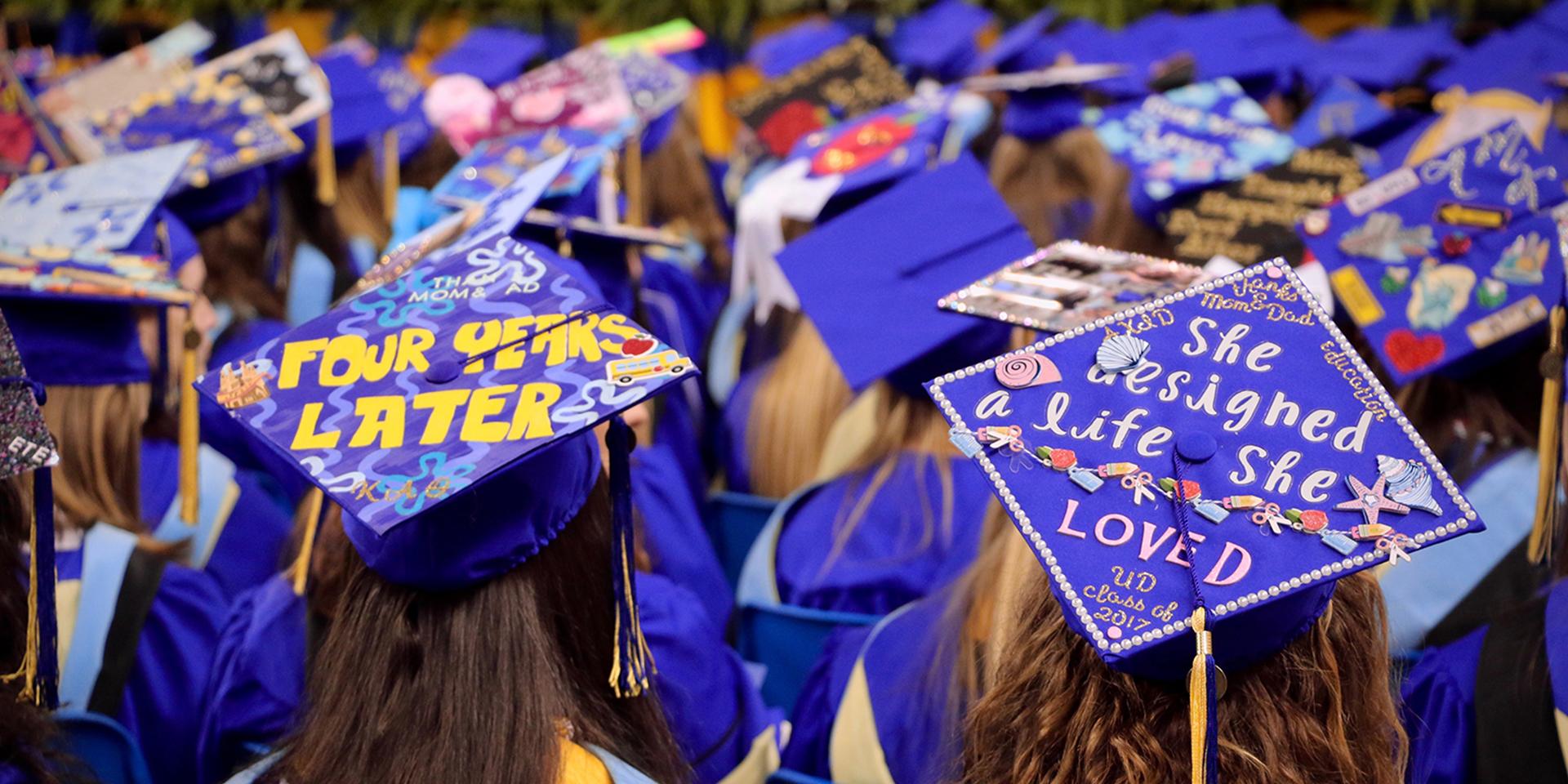 Decorated graduation caps at convocation ceremony