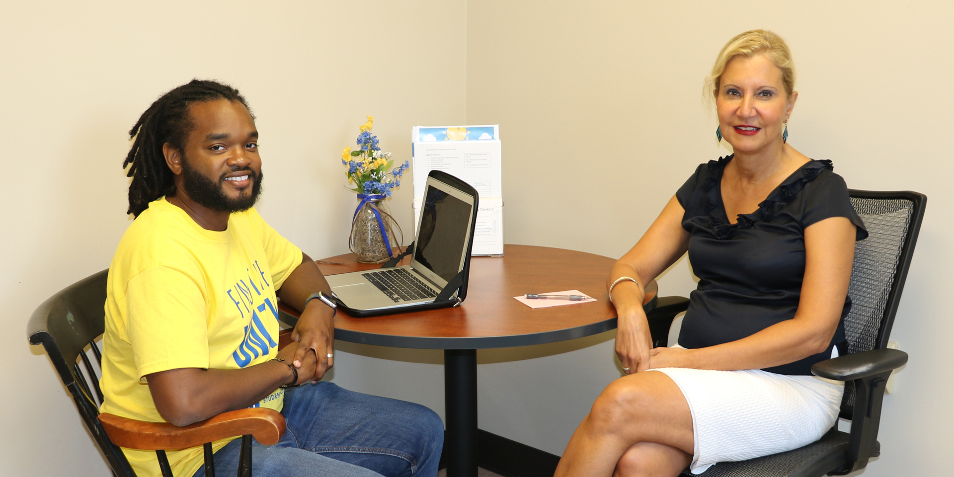 Department chair Bahira Trask talks with doctoral student
