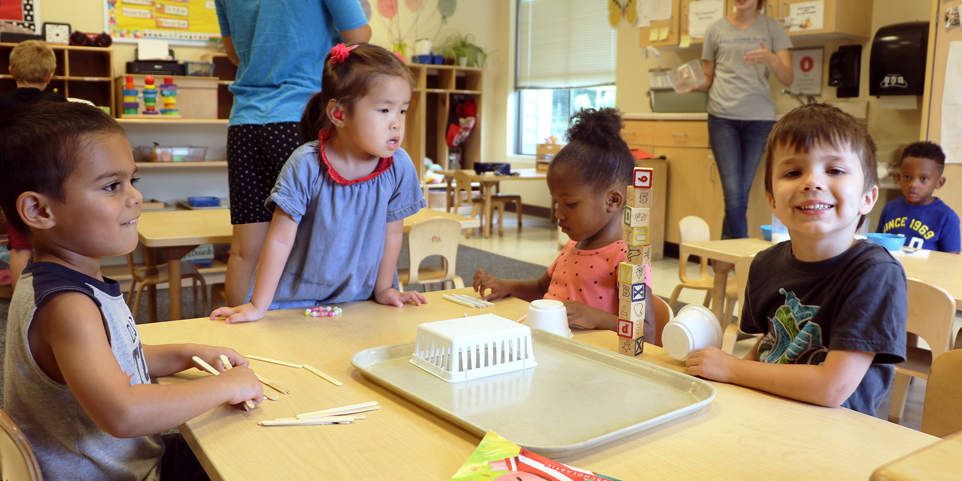 Four preschool children at the Early Learning Center